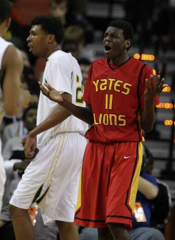 Yates Marquez Letcher-Ellis (11) reacts after a foul was called on him during the second half of the UIL 3A boys state basketball final game between Dallas Madison and Houston Yates at the Frank Erwin Center, Saturday, March 9, 2013, in Austin.  Yates lost the game. Photo: Karen Warren, Houston Chronicle / © 2013 Houston Chronicle