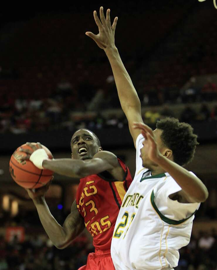 Yates Darrion Martin (23) goes up for a basket against Dallas Madison's Devonte Robinson (20) during the second half of the UIL 3A boys state basketball final game between Dallas Madison and Houston Yates at the Frank Erwin Center, Saturday, March 9, 2013, in Austin.  Yates lost the game. Photo: Karen Warren, Houston Chronicle / © 2013 Houston Chronicle