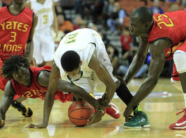 Dallas Madison's Cameron Bryant (2) battles for a loose ball with Yates Ikeanna Ozz (0) and Sadiq Inuwa (25) during the second half of the UIL 3A boys state basketball final game between Dallas Madison and Houston Yates at the Frank Erwin Center, Saturday, March 9, 2013, in Austin.  Yates lost the game. Photo: Karen Warren, Houston Chronicle / © 2013 Houston Chronicle