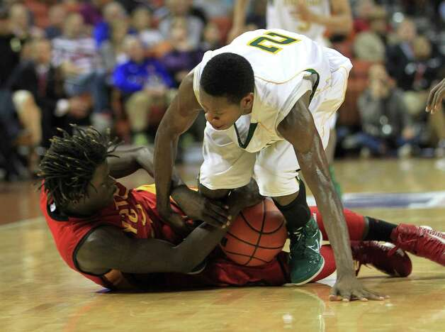 Dallas Madison's Cameron Bryant (2) battles for a loose ball with Yates Ikeanna Ozz (0) during the second half of the UIL 3A boys state basketball final game between Dallas Madison and Houston Yates at the Frank Erwin Center, Saturday, March 9, 2013, in Austin.  Yates lost the game. Photo: Karen Warren, Houston Chronicle / © 2013 Houston Chronicle