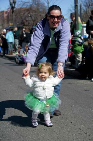Gianna Zezima, who will be 1 on Saint Patrick's Day, walks with her mother, Kathleen, before Saturday's parade in Stamford, Conn., on March 9, 2013. Photo: Lindsay Perry / Stamford Advocate