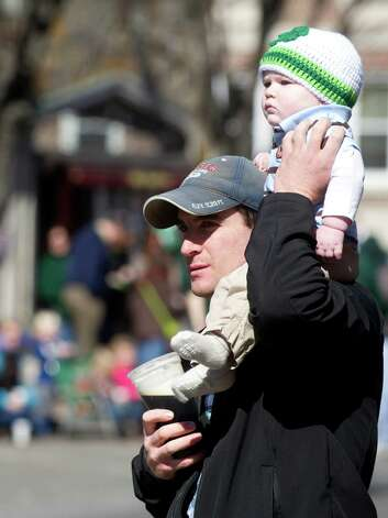 Jake Green holds his son, Lucas, 9 months, during Saturday's Saint Patrick's Day parade in Stamford, Conn., on March 9, 2013. Photo: Lindsay Perry / Stamford Advocate