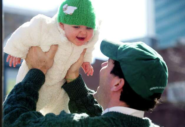 Paul Curtin plays with 7-month-old Quinn before Saturday's Saint Patrick's Day parade in Stamford, Conn., on March 9, 2013. Photo: Lindsay Perry / Stamford Advocate