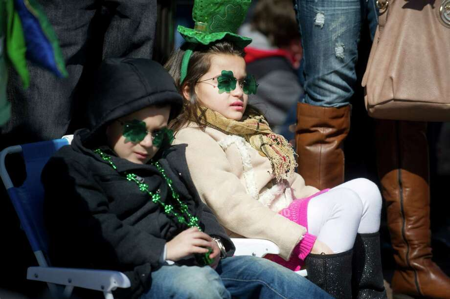 Nico Caruso, 4, and his sister, Adriana, 6, relax in their festive attire as they watch Saturday's Saint Patrick's Day parade in Stamford, Conn., on March 9, 2013. Photo: Lindsay Perry / Stamford Advocate