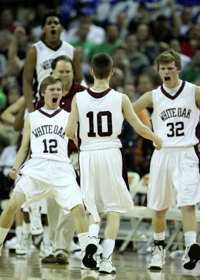 White Oak's Slade Sutton (10) is surrounded by teammates Dylan Gale (12) and Gabe Michael (32) after hitting a three pointer at the buzzer during the second half of the UIL 2A boys state basketball final game between White Oak and Brock at the Frank Erwin Center, Saturday, March 9, 2013, in Austin.  White Oak won the game 56-54. Photo: Karen Warren, Houston Chronicle / © 2013 Houston Chronicle