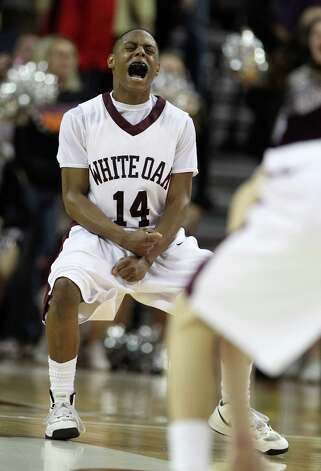 White Oak's Kris Anderson (14) reacts to his go-ahead basket with two seconds left in the game during the second half of the UIL 2A boys state basketball final game between White Oak and Brock at the Frank Erwin Center, Saturday, March 9, 2013, in Austin.  White Oak won the game 56-54. Photo: Karen Warren, Houston Chronicle / © 2013 Houston Chronicle