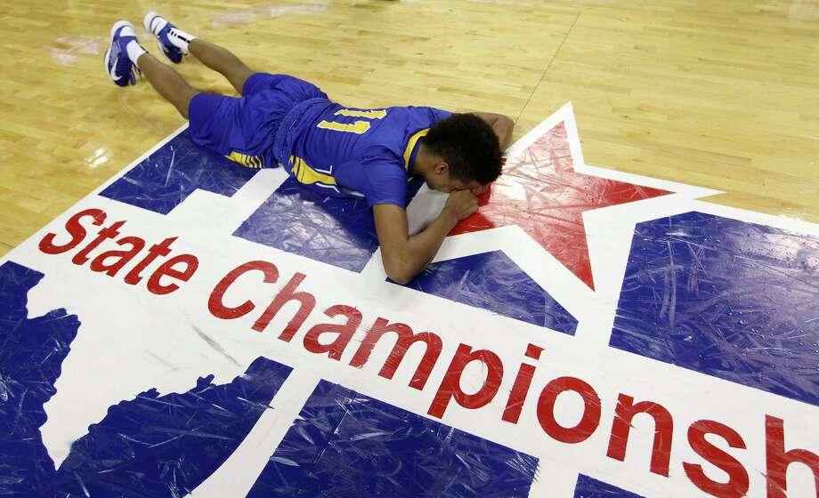Brock's Tre Ewell (11) lies on the ground as White Oak celebrates their win in the background after the UIL 2A boys state basketball final game between White Oak and Brock at the Frank Erwin Center, Saturday, March 9, 2013, in Austin.  White Oak won the game 56-54. Photo: Karen Warren, Houston Chronicle / © 2013 Houston Chronicle