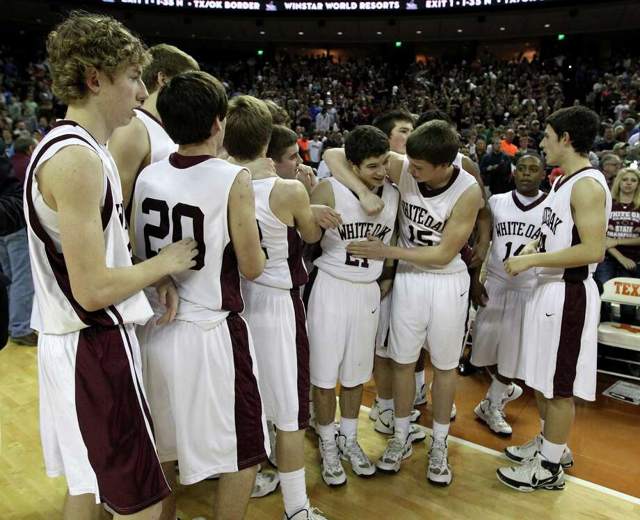 White Oak celebrates their win after the UIL 2A boys state basketball final game between White Oak and Brock at the Frank Erwin Center, Saturday, March 9, 2013, in Austin.  White Oak won the game 56-54. Photo: Karen Warren, Houston Chronicle / © 2013 Houston Chronicle