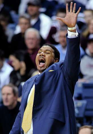 Providence coach Ed Cooley shouts to his team during the first half of their after his team's 63-59 overtime loss to Connecticut in an NCAA college basketball game in Storrs, Conn., Saturday, March 9, 2013. (AP Photo/Fred Beckham) Photo: Fred Beckham, Associated Press / FR153656 AP