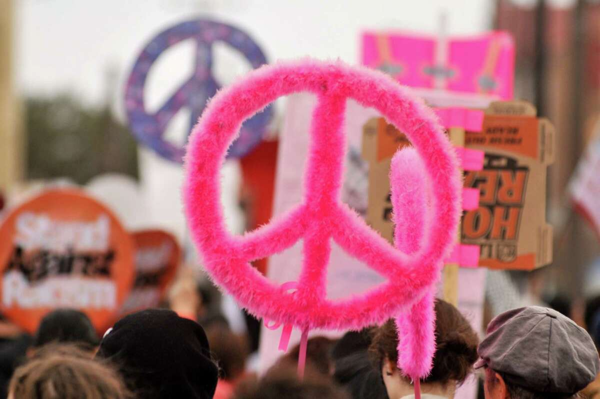 Vibrant, fuzzy peace symbols were part of the 23rd annual International Women's Day March & Rally in San Antonio Saturday, March 9, 2013. The purpose of the march is to raise awareness about domestic violence, pay-equity, and the struggles of low-income workers and families.