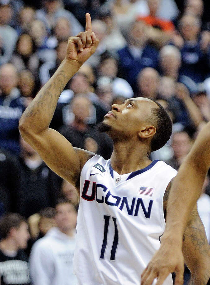 Connecticut's Ryan Boatright reacts after making a free-throw late in overtime of his team's 63-59 win over Providence in an NCAA college basketball game in Storrs, Conn., Saturday, March 9, 2013. (AP Photo/Fred Beckham) Photo: Fred Beckham, Associated Press / FR153656 AP