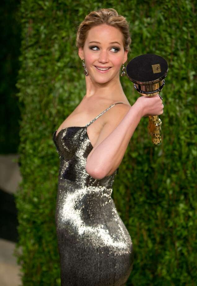 Celebrities don't always look poised and glamorous in pictures. Here's a look, starting with Jennifer Lawrence having some fun with her Oscar for best actress, after she ...