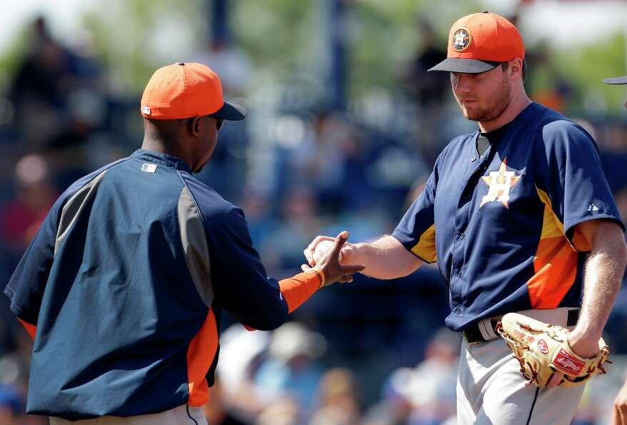 Mets 9, Astros 6Astros starting pitcher Alex White, right, is