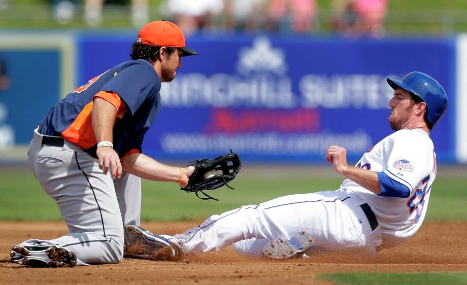 Ike Davis, right, is safe at second for a stolen base as he slides under the tag of Brett Wallace during the first inning. Photo: Jeff Roberson