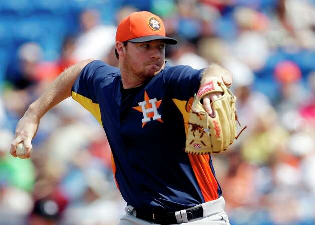 Astros starting pitcher Alex White throws during the first inning. Photo: Jeff Roberson