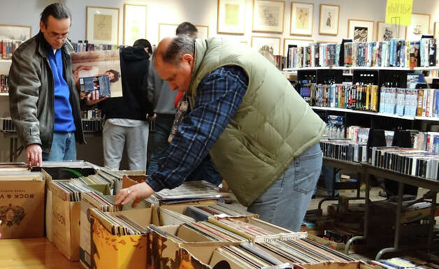 Row upon row of records attracted browsers Saturday at the Westport Public LIbrary book sale.  WESTPORT NEWS, CT 3/9/13 Photo: Mike Lauterborn / Westport News contributed