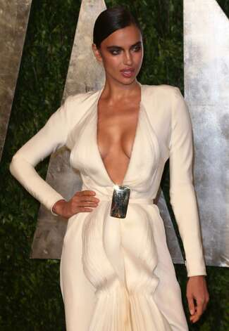 Looking lop-sided and half-naked is a feat. (Model Irina Shayk, Vanity Fair Oscar Party, 2013).