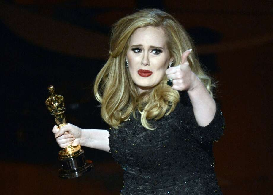 Now for a look at the popular ''thumbs up'' pose, which is tricky when your thumb looks like part of a talon. (Adele, with her Oscar for best original song, 2013).