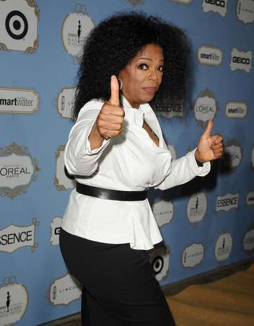 Two thumbs up did not help out Oprah Winfrey (Beverly Hills, 2013).