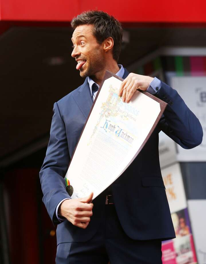 Hugh Jackman's tongue getting some exposure at his ''Hollywood Walk of Fame'' star (2012).