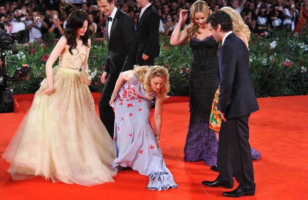 Which is probably worse than cleaning the carpet when you have to adjust your gown. (Madonna, center, with Andrea Riseborough, left, at the Venice Film Festival, 2011).