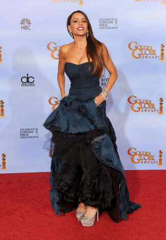 Nothing underneath but shoes and a petticoat. (Sofia Vergara, 2012).