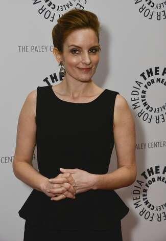 What to do with your hands when you don't have a cute clutch? Vulcan death-grip your fingers. (Tina Fey, 2013).