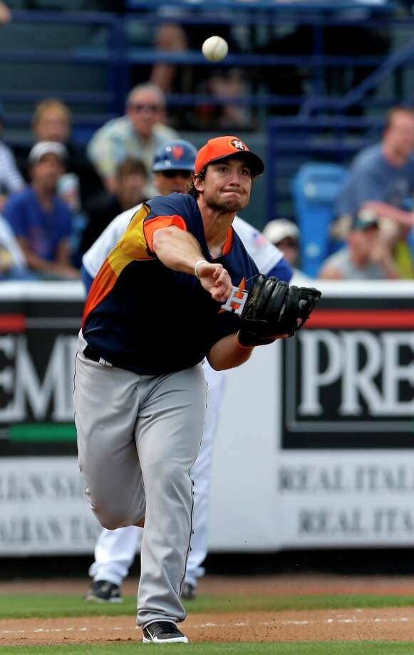 Astros third baseman Brett Wallace makes a throw to first base. Photo: Jeff Roberson