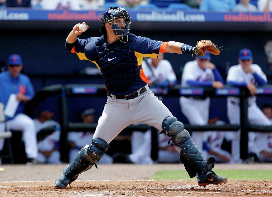 Astros catcher Jason Castro looks to throw out a runner. Photo: Jeff Roberson