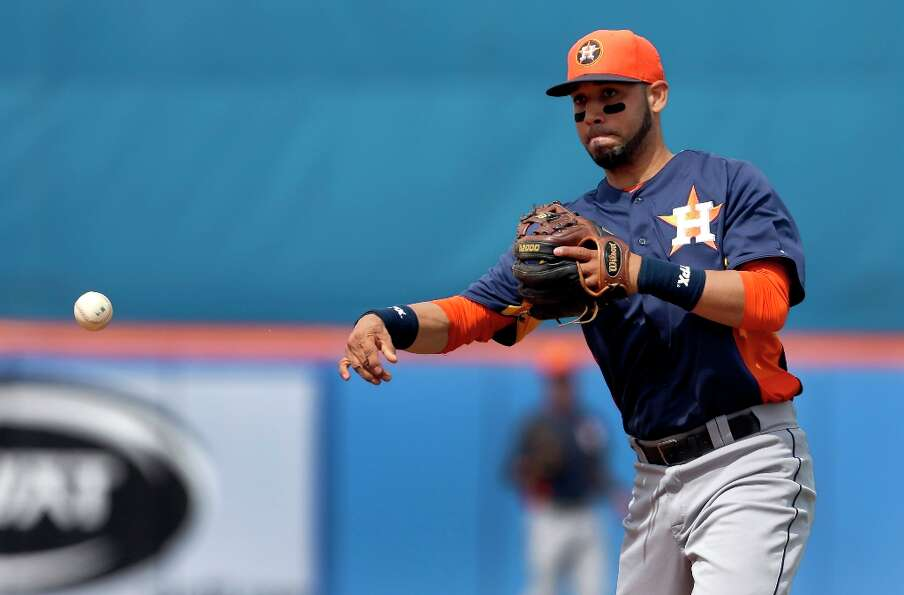Astros second baseman Marwin Gonzalez makes a throw to first.