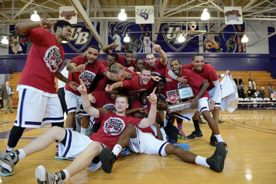 University of Bridgeport players celebrate winning their ECC title on Saturday at the Harvey Hubbell gym by defeating Dowling. Photo: Contributed Photo