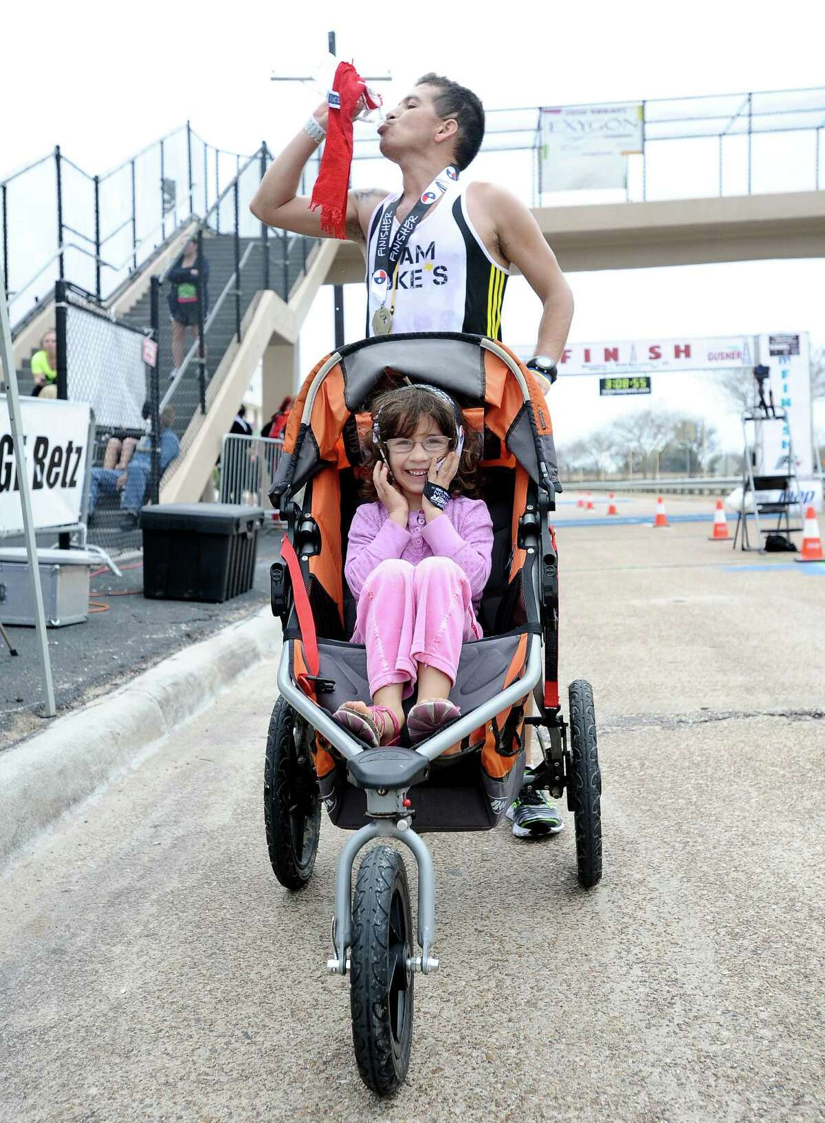Iram Leon and daughter Kiana Leon finish the Gusher Marathon in 3 hours 7 minutes and 35 seconds taking first place in the full marathon on Saturday, March 9, 2013. Photo taken: Randy Edwards/The Enterprise