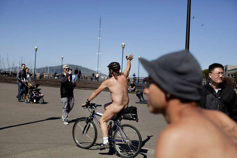 A man who goes by the name Nüd and other nude and partially nude cyclists rode along the Embarcadero for the World Naked Bike Ride in San Francisco, Calif., Saturday, March 9, 2013. Photo: Jason Henry, Special To The Chronicle