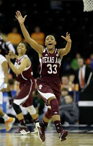 Texas A&M guard Courtney Walker (33) reacts as time expires in their 66-62 win over Tennessee ina n NCAA college basketball game at the Southeastern Conference tournament, Saturday, March 9, 2013, in Duluth, Ga. (AP Photo/John Bazemore) Photo: John Bazemore, Associated Press / AP
