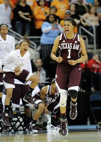 Texas A&M forward Courtney Williams (1) reacts after sinking a basket in the closing moments against Tennessee during the second half of an NCAA college basketball game in the Southeastern Conference tournament on Saturday, March 9, 2013, in Duluth, Ga. Texas A&M won 66-62. (AP Photo/John Amis) Photo: John Amis, Associated Press / FR69715 AP