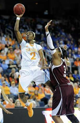 Tennessee forward Jasmine Jones (2) shoots while defended by Texas A&M center Kelsey Bone (3) during the second half of an NCAA college basketball game in the Southeastern Conference women's tournament, Saturday, March 9, 2013, in Duluth, Ga. Texas A&M won 66-62. (AP Photo/John Amis) Photo: John Amis, Associated Press / FR69715 AP