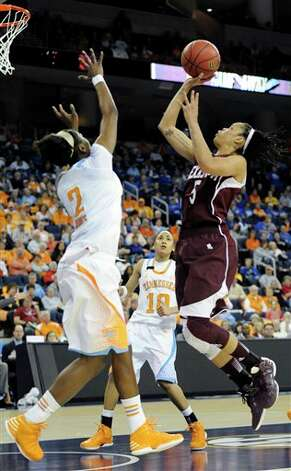 Texas A&M forward Kristi Bellock (5) shoots as Tennessee forward Jasmine Jones (2) defends during the first  half of a NCAA college basketball game in the Southeastern Conference tournament, Saturday, March 9, 2013, in Duluth, Ga. (AP Photo/John Amis) Photo: John Amis, Associated Press / FR69715 AP