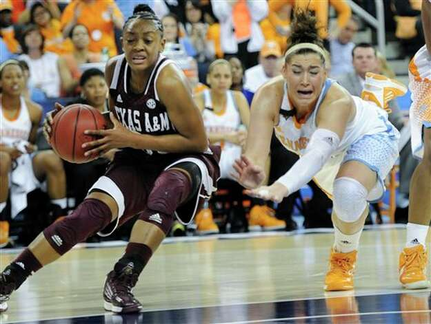 Texas A&M guard Courtney Walker (33) gets by a diving Tennessee guard Taber Spani (13) during the first half of a NCAA college basketball game in the Southeastern Conference tournament, Saturday, March 9, 2013, in Duluth, Ga. (AP Photo/John Amis) Photo: John Amis, Associated Press / FR69715 AP
