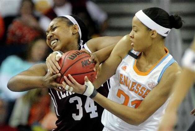 Texas A&M center Karla Gilbert (34) and Tennessee center Nia Moore (21) wrestle for the ball during the first half of an NCAA college basketball game in the Southeastern Conference tournament on Saturday, March 9, 2013, in Duluth, Ga. (AP Photo/John Amis) Photo: John Amis, Associated Press / FR69715 AP