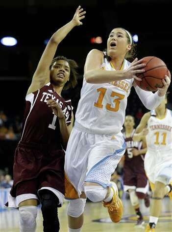 Tennessee guard Taber Spani (13) drives against Texas A&M guard Courtney Williams (1) during the first half of their NCAA college basketball game in the Southeastern Conference tournament, Saturday, March 9, 2013, in Duluth, Ga. Spani scored 18 points in the first half.  (AP Photo/John Bazemore) Photo: John Bazemore, Associated Press / AP
