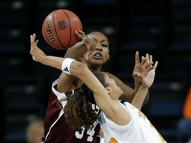 Texas A&M center Karla Gilbert (34) and Tennessee guard Meighan Simmons (10) vie for a rebound during the first half of an NCAA college basketball game in the Southeastern Conference women's tournament, Saturday, March 9, 2013, in Duluth, Ga. (AP Photo/John Bazemore) Photo: John Bazemore, Associated Press / AP