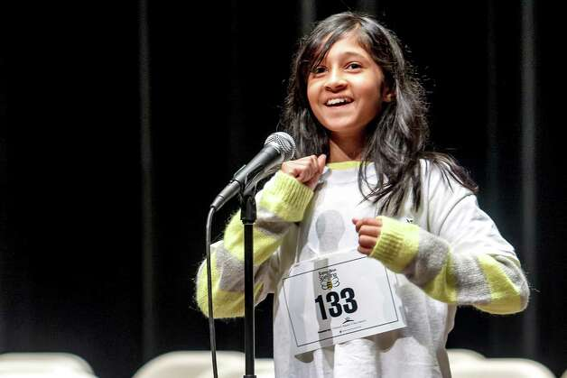 "Twelve-year-old Swati Sharma, a seventh grade student from Saint Mary's Hall Middle School, reacts after winning the San Antonio Express-News' Regional Spelling Bee at Trinity University's Laurie Auditorium on Saturday, March 9, 2013.  Sharma correctly spelled the anticipated championship word ""bullionist"" to win the competition. Photo: Marvin Pfeiffer, San Antonio Express-News / Express-News 2013"