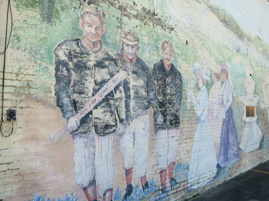 A fading mural on a downtown building commemorates Marlin as a long-ago spring training site for the N.Y. Giants and other major league baseball teams. Giants manager John McGraw believed in the town's waters. Photo: Joe Holley/ Chronicle
