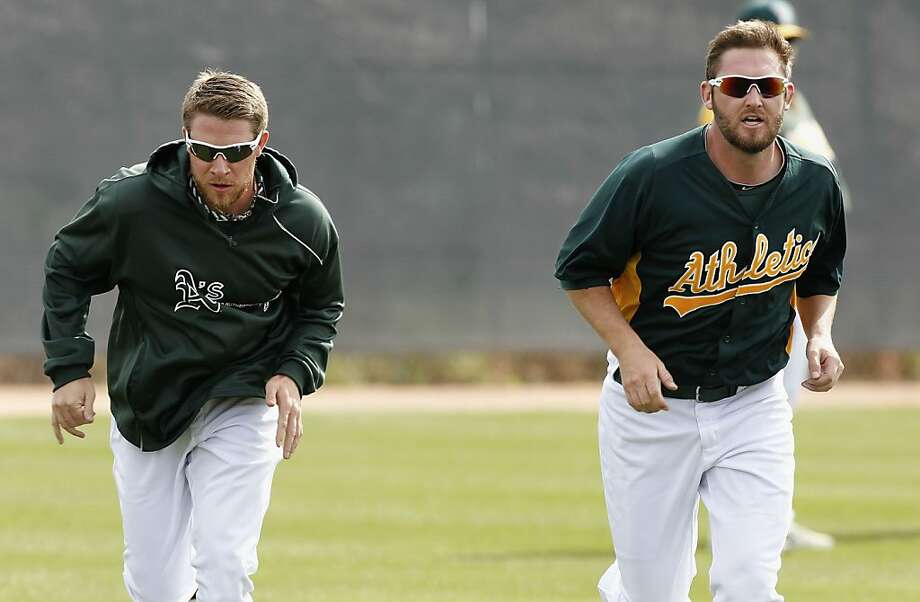 Sean Doolittle (left) and Ryan Cook are complementary setup men, and good friends, too. Photo: Michael Macor, The Chronicle