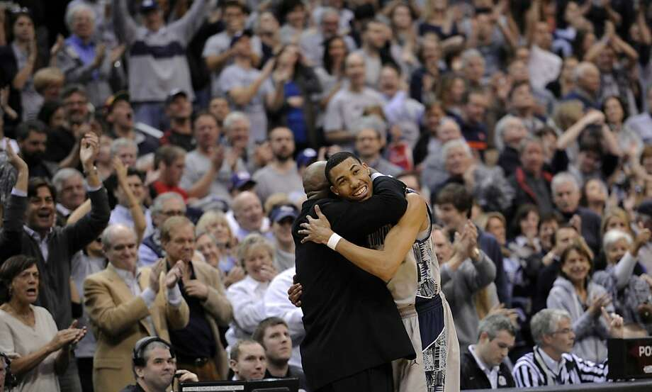 Georgetown's Otto Porter Jr. gets a hug from Georgetown coach John Thompson III during Saturday's win. Photo: Nick Wass, Associated Press