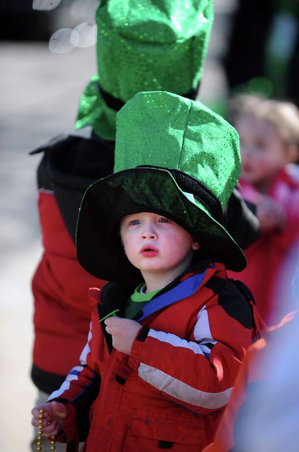 Three-year-old Connor Michels, of Milford, watches the marchers during the annual St. Patrick's Day Parade in downtown Milford, Conn. Saturday, Mar. 9, 2013. Photo: Autumn Driscoll / Connecticut Post