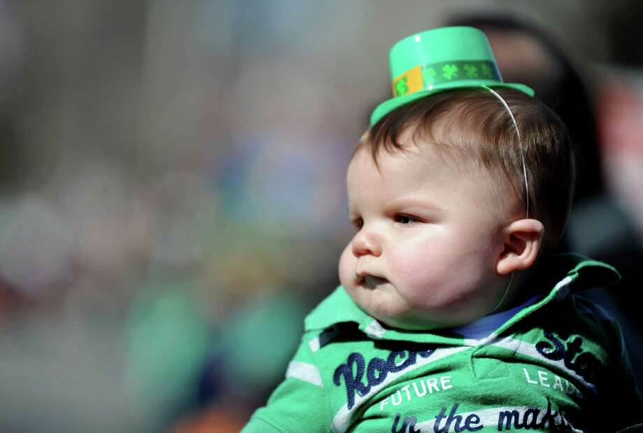Six-month-old Nathan DeZenzo, of Milford, watches the marchers during the annual St. Patrick's Day Parade in downtown Milford, Conn. Saturday, Mar. 9, 2013. Photo: Autumn Driscoll / Connecticut Post