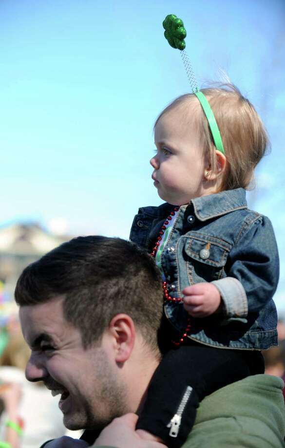 One-year-old Lucy Sciarappa, of Milford, has a bird's eye view from atop dad Chris' shoulders during the annual St. Patrick's Day Parade in downtown Milford, Conn. Saturday, Mar. 9, 2013. Photo: Autumn Driscoll / Connecticut Post