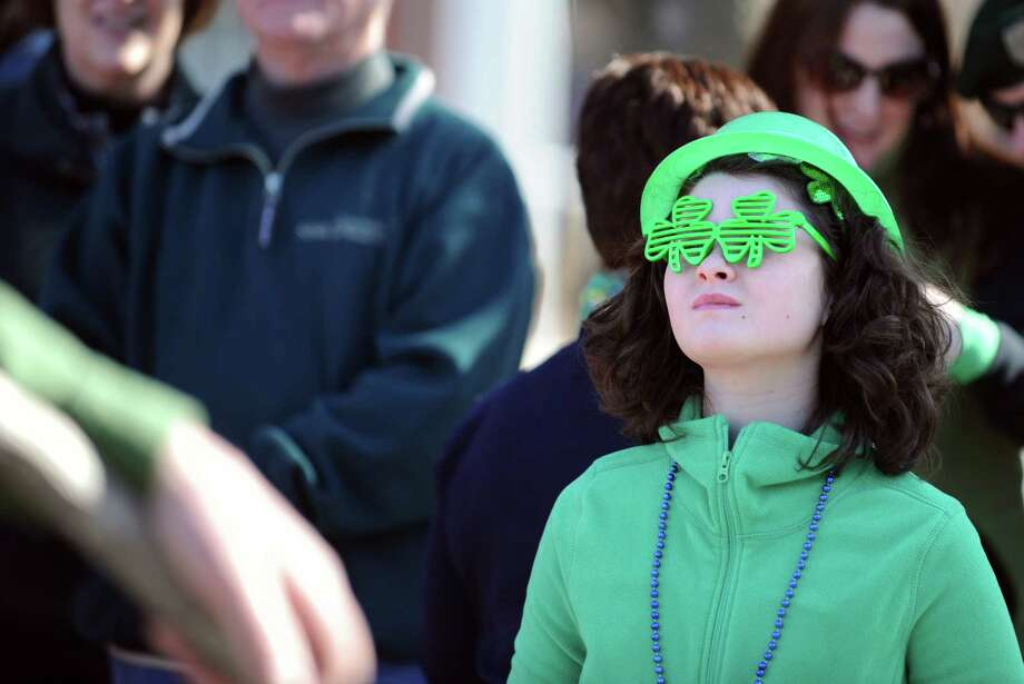 Ten-year-old Margaret Scull, of Branford, watches the marchers during the annual St. Patrick's Day Parade in downtown Milford, Conn. Saturday, Mar. 9, 2013. Photo: Autumn Driscoll / Connecticut Post