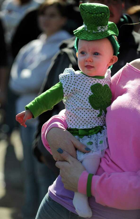Five-month-old Peyton Hagedorn, of Milford, watches the marchers during the annual St. Patrick's Day Parade in downtown Milford, Conn. Saturday, Mar. 9, 2013. Photo: Autumn Driscoll / Connecticut Post